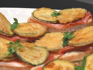 Courgette pintxos with cured ham shoulder